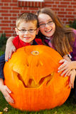 Children proud of their jack-o-lantern Royalty Free Stock Image