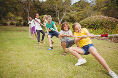 Children Pulling A Rope In Tug Of War Royalty Free Stock Image