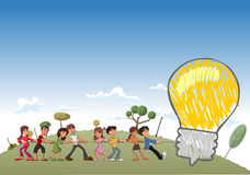 Children pulling a big idea light bulb Stock Photos