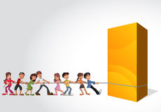 Children pulling a big yellow box Stock Photo