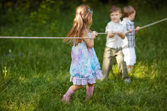 Children pulling the rope outdoors. Photo of children pulling the rope outdoors Stock Images
