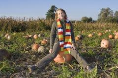 Children on pumpkin field Royalty Free Stock Photo