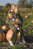 Children on pumpkin field Stock Photo