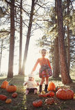 Children at pumpkin patch. Two little children during october at the pumpkin patch Royalty Free Stock Images
