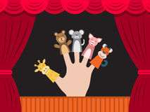 Children puppet theatre. Puppet theater for finger toys animals. Doll is wearing on the fingers of the human hand and all is depicted on the background of a Stock Photos