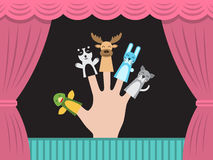 Children puppet theatre. Puppet theater for finger toys animals. Doll is wearing on the fingers of the human hand and all is depicted on the background of a Stock Image