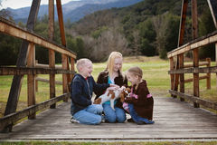 Children with Puppy Stock Photography