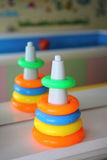 Children pyramid toy before a Mirror Royalty Free Stock Image