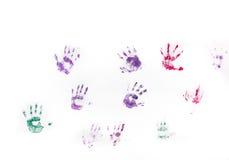 Children ręki druki na biel ścianie Obrazy Stock