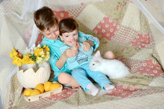 Children and rabbit Stock Photo