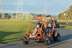 Children racing in gocarts Stock Image