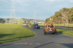 Children racing in gocarts. Children on the race track in dune buggies at Gumbuyah Park in Tynong North, Victoria Australia; 8th July, 2015 Stock Image