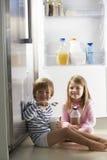 Children Raiding The Fridge Stock Photo