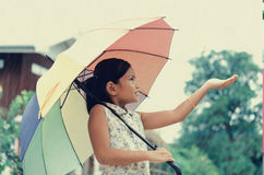 Children in the rain Have fun playing in park  have umbrellas Royalty Free Stock Image