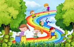 Children and rainbow Stock Photo