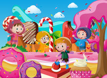 Children in raincoats playing in candyland Stock Images