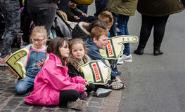 Children at rally ceremonial finish. Brampton, UK - April 30, 2017:  Children with foam hands watching the ceremonial finish for the Pirelli International Rally Stock Photos