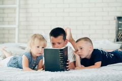 A children read a bible on the bed Stock Photo