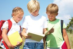 Children read a book Stock Image