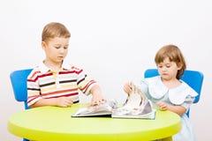 Children read the book Stock Photos