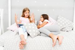 Children read book in bed. Reading before bed can help sleep better at night. Stories every kid should read. Family. Tradition. Girls best friends read fairy royalty free stock photo
