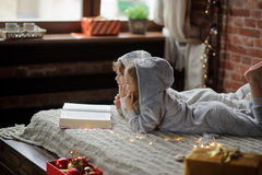 The children read a great book with Christmas tales. Royalty Free Stock Photos