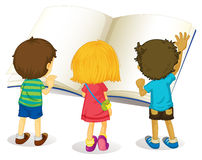 Children reading from big book Royalty Free Stock Image