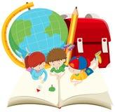 Children reading big book Royalty Free Stock Image