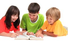 Children reading book Stock Photos