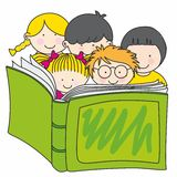 Children reading a book Stock Photos