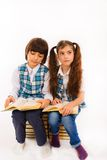 children reading a book Stock Photo
