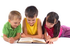 Children reading book. Group of children reading book together Royalty Free Stock Photos