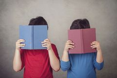 Children reading a book. On gray background Royalty Free Stock Images