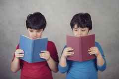 Children reading a book. On gray background Stock Image