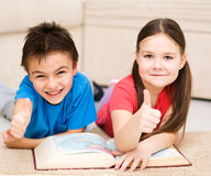 Children is reading book stock photos