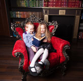 Children reading book at home. Boy and girl in library Royalty Free Stock Photography