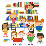 Children reading a book in a library Royalty Free Stock Image