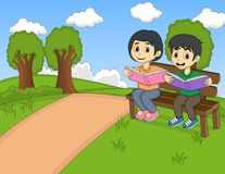 Children reading a book in the park cartoon Royalty Free Stock Photography