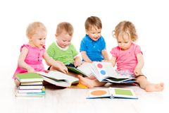 Children Reading Books, Babies Early Education, Kids Group, White. Children Reading Books, Babies Early Education, Group of Kids one year old, Boys and Girls stock photography