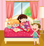 Children reading books in bedroom Royalty Free Stock Photography