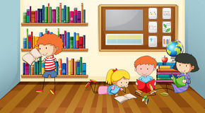 Children reading books in classroom Royalty Free Stock Photography