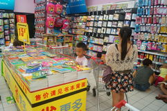 The children are reading books in the store. Royalty Free Stock Images