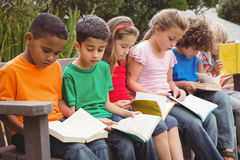 Children reading from books together Stock Photography