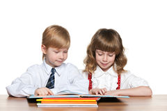 Children are reading at the desk Stock Photo