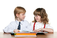 Children are reading at the desk Stock Image