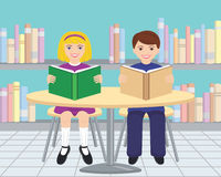 Children Reading in the Library. A girl and boy sitting at a table in the library reading books Royalty Free Stock Photo
