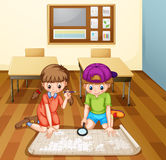 Children reading map in classroom Royalty Free Stock Image
