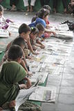 CHILDREN READING A NEWSPAPER ON A NATIONAL PRESS Stock Photo