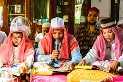 The Children reading Quran for ceremony in Graduation of the Quran. BANGKOK - APRIL 13 : The Children reading Quran for ceremony in Graduation of the Quran on Stock Images