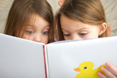 Children reading a story Stock Photography